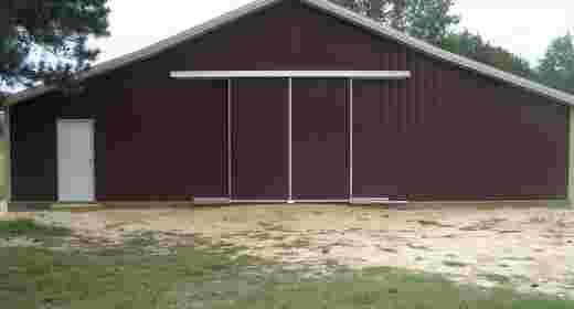 North Carolina post framefarm building with split slider doors